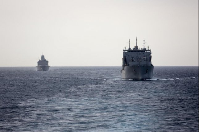 The amphibious transport dock ship USS New York, left, and the dry cargo and ammunition ship USNS William McLean move through the Strait of Hormuz. The Bataan Amphibious Ready Group, with embarked 26th Marine Expeditionary Unit, is deployed to the U.S. 5th Fleet area of operations in support of naval operations to ensure maritime stability and security in the Central Region, connecting the Mediterranean and the Pacific through the western Indian Ocean and three strategic choke points. Photo by Nathan Reyes/U.S. Marine Corps