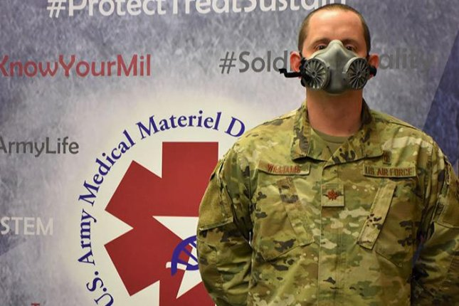 Air Force Maj. Daniel Williams demonstrates the fit of an N95 elastomeric half-mask respirator, which is among the designs that theU.S. Army Medical Materiel Development Activity has been testing after 3D printing them. Photo byJeffrey Soares/U.S. Army