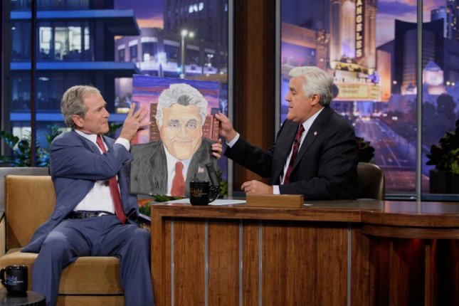 George W. Bush not worried about history, shows off paintings
