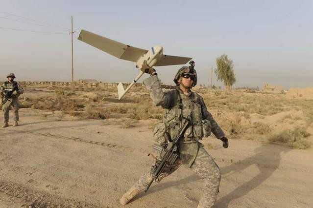 A U.S. Army soldier launches a RQ-11B Raven. Photo: SPC. Joshua E. Powell, U.S. Army.
