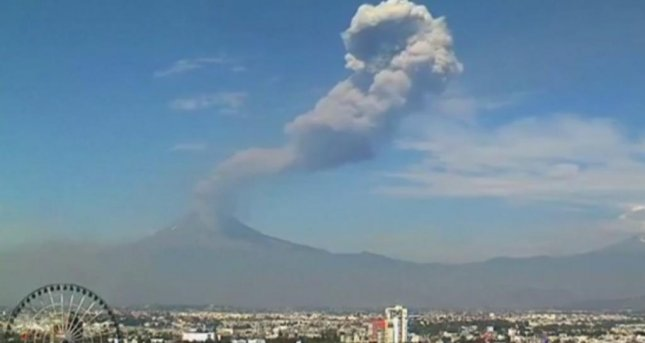 An eruption at Mexico's Popocatépetl volcano led officials to declare a 7-mile exclusion zone around it as falling ash could endanger people living in the immediate area. Screenshot courtesy Hotel Holiday Inn La Noria/webcamsdemexico.com