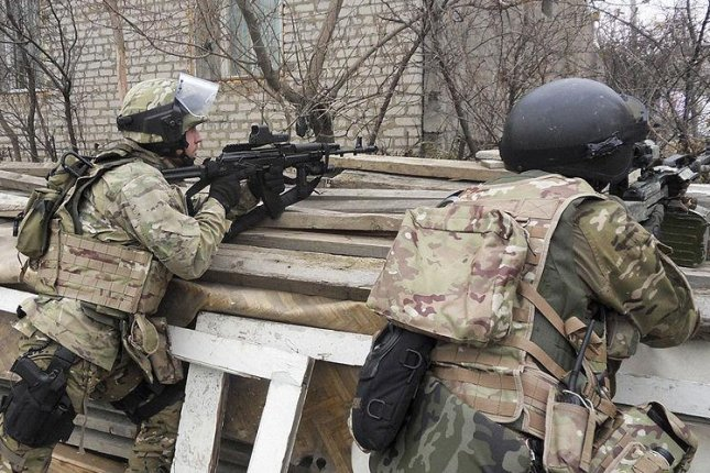FSB special forces members during a special operation. Russia's National Antiterror Committee (NAK) said that security forces killed eight Islamic State militants Sunday, and six other Islamist rebels on Monday. Photo by WIkiCommons.