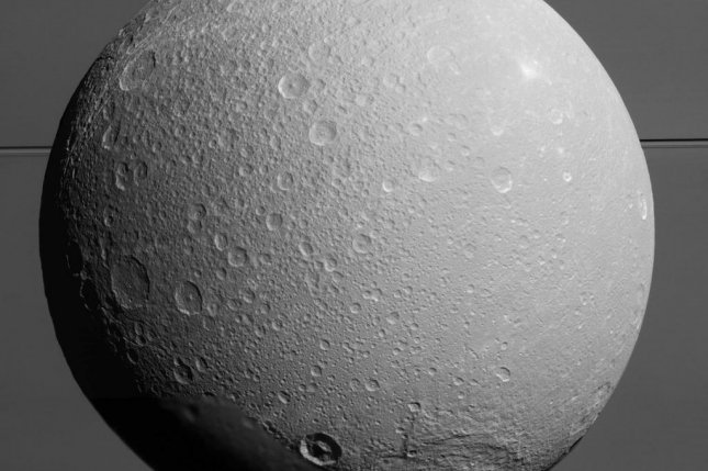 New analysis of gravity data collected by the Cassini mission suggests Saturn's moon Dione hosts an ocean deep beneath its surface. Photo by NASA/JPL-Caltech/Space Science Institute
