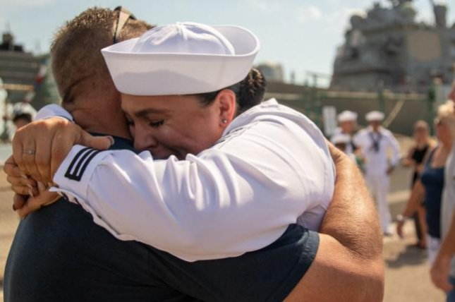 Seaman Katie Helps embraces her father after the USS Donald Cook, forward deployed in Rota, Spain, for seven years, pulled into its new home port Naval Station Mayport in Florida. Photo courtesy U.S. Navy
