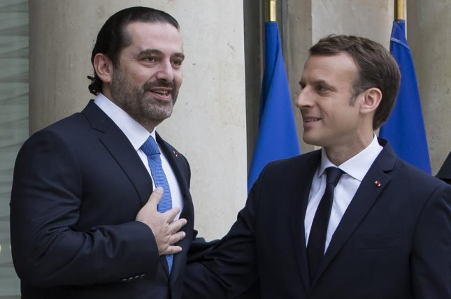 French President Emmanuel Macron greets Lebanese Prime Minister Saad Hariri as he arrives for a meeting at the Elysee Palace in Paris, France, November 18, 2017. Photo by EPA-EFE/Ian Langsdon
