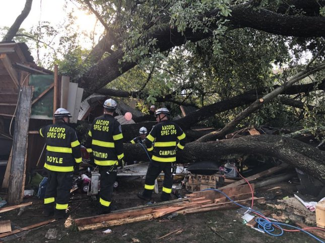 A tree fell on a garage in Pasadena, Maryland, Sunday, injuring 19 people. Photo courtesy of Anne Arundel County Fire Department/Twitter