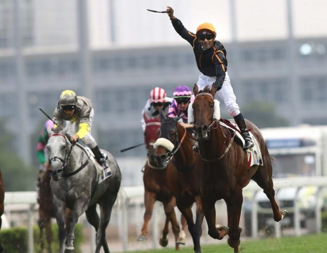 Jockey Karis Teetan celebrates after Able Friend wins Sunday's Premier Bowl at Sha Tin in Hong Kong. (HKJC photo)