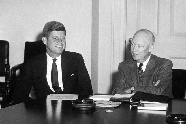 President-Elect John F. Kennedy and President Dwight D. Eisenhower seated together at a table during their meeting in the Cabinet Room of the White House, Washington, DC, on January 19, 1961. Photo courtesy JFK Presidential Library