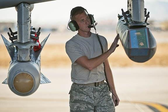 Staff Sgt. Jamie Case conducts preflight checks on a targeting pod attached to an A-10 Thunderbolt II at Nellis Air Force Base in Nevada in December 2010. Photo by Tech. Sgt. Michael R. Holzworth/U.S. Air Force