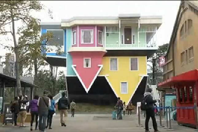 This house is upside-down. Seriously. Screenshot: BBC video