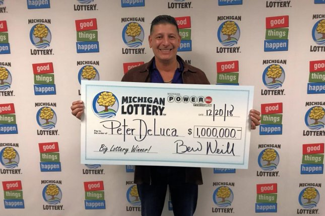 A Michigan man said he forgot about his Powerball ticket for two months until he found it in his car and discovered it was a $1 million winner. Photo courtesy of the Michigan Lottery