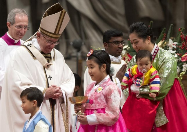 Pope's Midnight Mass urges Catholics to turn away from commercialism of Christmas
