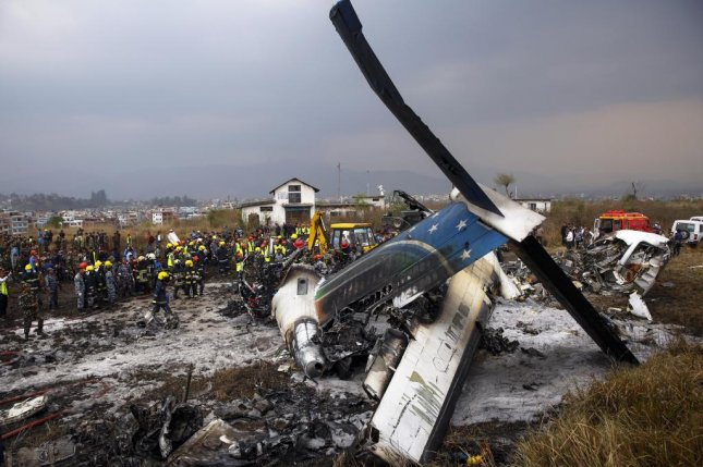 Rescue teams work at the wreckage of a US-Bangla plane that crashed at Tribhuvan International Airport in Kathmandu, Nepal, on March 12, 2018. Photo by Narendra Shrestha/EPA-EFE