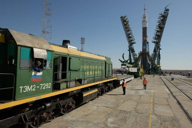 The gantry arms were closed around the Soyuz rocket Monday after it was transported to the launch pad and raised into vertical position at the Baikonur Cosmodrome in Kazakhstan. Photo by NASA/Bill Ingalls