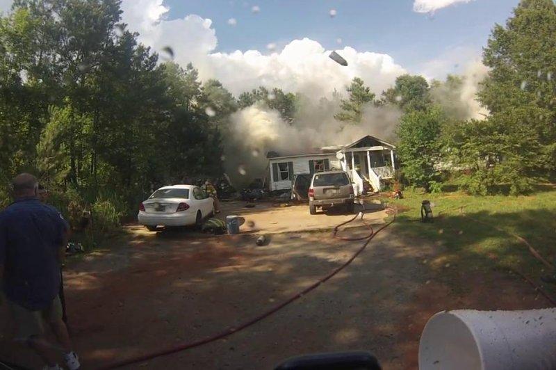 South Carolina house fire shoots aerosol at fire engine