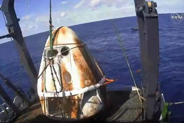 SpaceX's Crew Dragon was craned onto the deck of the company's recovery ship. Photo by NASA TV/SpaceX