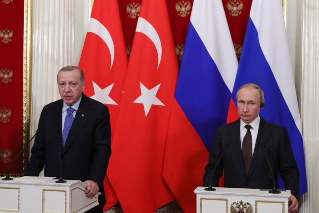 Russian President Vladimir Putin (R) and Turkish President Recep Tayyip Erdogan (L) attend a joint news conference following their cease-fire talks in the Kremlin in Moscow. Turkey said Friday it killed 21 Syrian soldiers in an airstrike. Photo by Michael Klimentyev/EPA-EFE