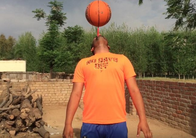 Sandeep Singh, 25, set a new Guinness World Record by balancing a spinning basketball on a toothbrush in his mouth for 53 seconds. 