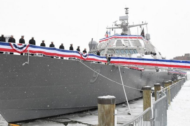 Crew members of the littoral combat ship USS Little Rock man the rails during the ship's commissioning ceremony in Buffalo, N.Y., on December 16, 2017. Photo courtesy of Lockheed Martin/US Navy