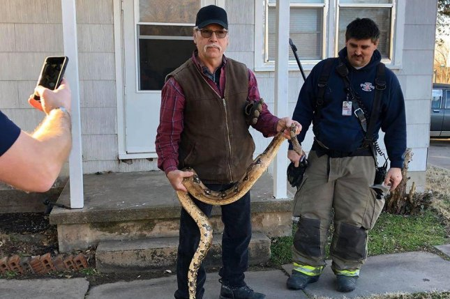 Police and firefighters responded to a duplex in Kansas where a resident found a large snake hiding in their couch. Photo courtesy of Butler County Fire District #3