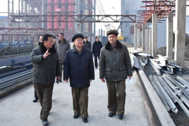 North Korean official Choe Ryong Hae (C) visits the Sunchon Phosphate Fertilizer Factory on Wednesday, according to state media. Photo by KCNA