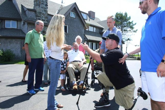 Retired Army Spc. Tyler Jeffries, who lost both legs in Afghanistan in 2012, proposed to his girlfriend with two former presidents watching. Photo from George Bush/Twitter