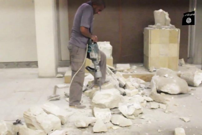 The Islamic State released a video purportedly showing men using sledgehammers and pickaxes to destroy 3,000-year-old artifacts at Iraq's Mosul Museum. YouTube screenshot