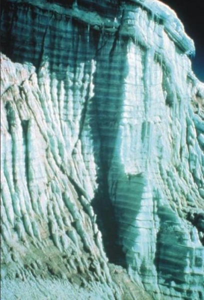This photo from a 1977 expedition to Quelccaya Ice Cap in Peru shows clearly defined annual layers of ice and dust visible in the ice cap's margin. Researchers at the Ohio State University are using a set of ice cores taken from Quelccaya as a Rosetta Stone for studying other ice cores taken from around the world. Credit: Lonnie Thompson/Ohio State University