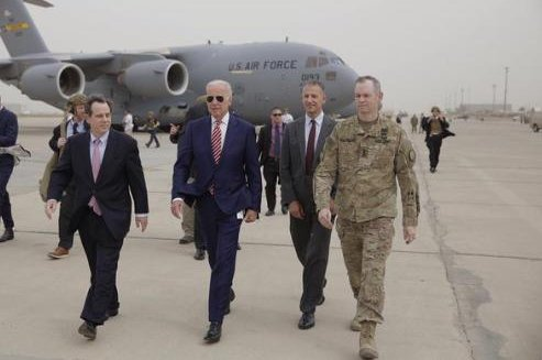 Vice President Joe Biden walks with U.S. Ambassador Stuart Jones and Army Lt. Gen. Sean MacFarland, who commands the Operation Inherent Resolve mission, after he arrived at Baghdad International Airport in Iraq on Thursday. Biden made the unannounced trip in an effort to soothe political strife in the country. Photo from Biden/Twitter