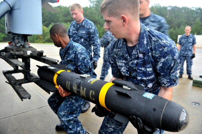 France receives approval to purchase more Hellfire missiles. Pictured, a Hellfire missile is loaded onto a helicopter. U.S. Navy photo by Mass Communication Specialist 3rd Class Scott A. Raegen