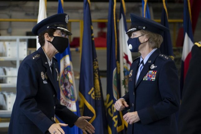 Gen. Jacqueline D. Van Ovost (L), incoming commander of Air Mobility Command, and Gen. Maryanne Miller, AMC commander, talk before the AMC change of command ceremony at Scott Air Force Base in Illinois on Thursday. Photo by Miranda Simpson/U.S. Air Force