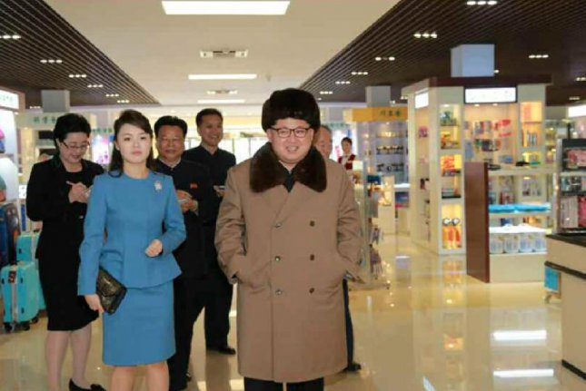In this photo that ran in the March 28 issue of a state newspaper, Kim Jong Un and his wife, Ri Sol Ju, visited what appeared to be a posh department store in Pyongyang. Photo by Rodong Sinmun
