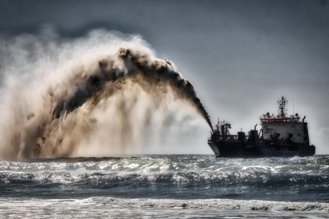 Dredger pumping sand and water to shore for beach renourishment, Mermaid Beach, Gold Coast, Australia, on August 20. Photo by Steve Austin