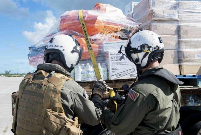 U.S. Navy personnel transport supplies in response to Hurricane Dorian in the Bahamas,on September 9, 2019. The Navy, Marines and Coast Guard began returning personnel, ships and helicopters from the Bahamas to home stations this week. Photo by MCS3 Katie Cox/U.S. Navy