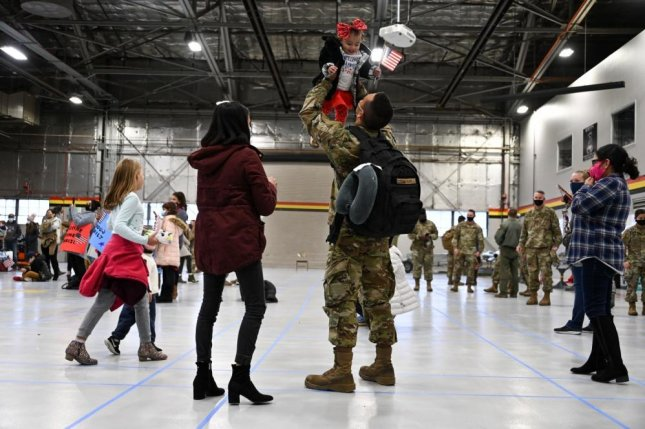 Airmen returned home for the holidays after deployment in the United Arab Emirates. Photo by Ronald Bradshaw/U.S. Air Force