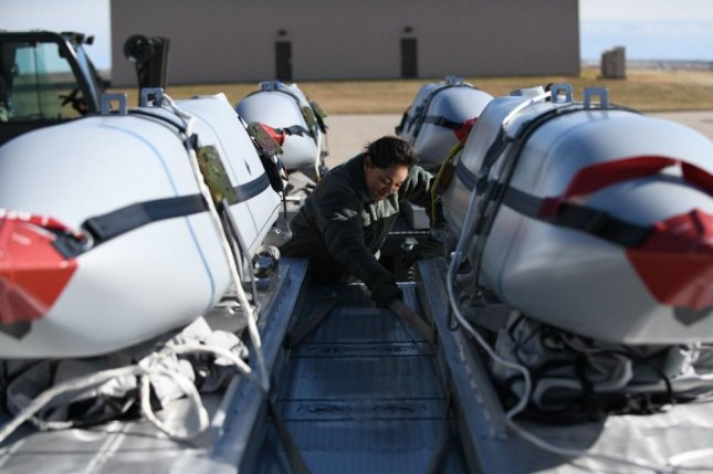 An Airman from the 28th Munitions Squadron secures Joint Air to Surface Standoff Missiles on a flatbed truck at the Munitions Storage Area on Ellsworth Air Force Base, S.D., in October 2019. Lockheed Martin has been awarded an $818.2 million contract to produce JASSMs for the Air force and the Foreign Military Sales program. Photo byChristina Bennett/U.S. Air Force