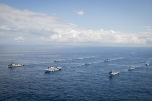 Naval ships from Brazil, Peru, Argentina and the United States conduct naval formations during a training exercise for UNITAS LX in Brazil Aug. 24, 2019. Photo by Daniel Barriospirela/U.S. Navy