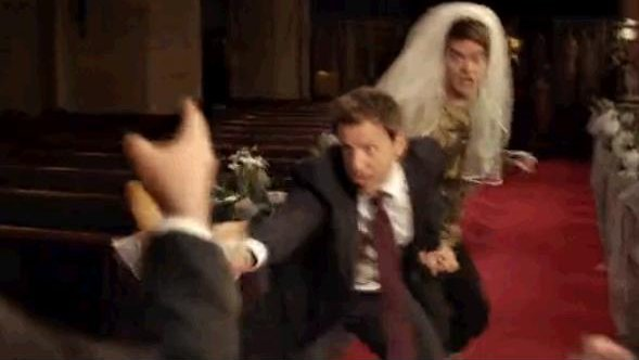 Seth rescues Stefon from a wedding to Anderson Cooper. (NBC)