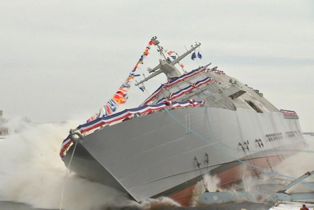 The future USS Sioux City (LCS 11) is launched into the Menominee River seconds after ship sponsor Mary Winnefeld, wife of retired Adm. James Sandy Winnefeld, christened the Freedom variant littoral combat ship. Photo by U.S. Navy/Lockheed Martin