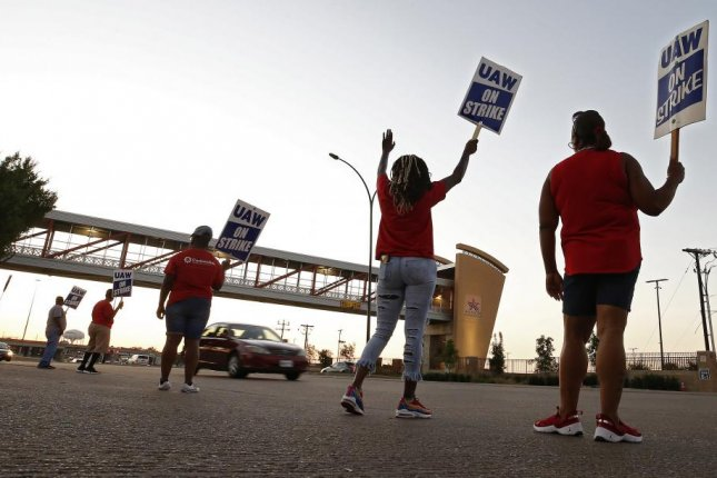 United Auto Workers members picket outside the General Motors plant in Arlington, Texas, on September 17. Photo by Larry W. Smith/EPA-EFE