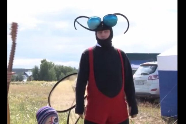 A reveler at the 2014 Mosquito Festival in Berezniki dressed in costume as a tribute to the insects. CityBerezniki/YouTube video screenshot