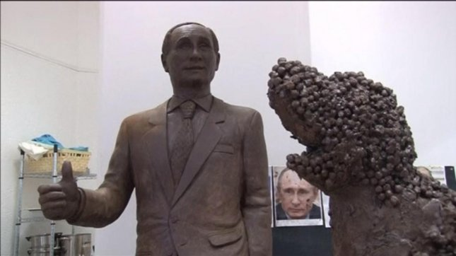 Chocolate sculptures of Russian President Vladimir Putin and his dog, Connie, are due to be shown at the Festival of Chocolate in St. Petersburg Dec. 5. Channel 3 News/YouTube video screenshot