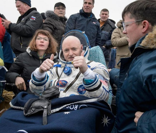 NASA astronaut Scott Kelly (C) gives two thumbs up after he and Russian cosmonaut Mikhail Kornienko returned to Earth on Tuesday (Wednesday, Kazakh time) from the International Space Station after nearly a year in space. Photo courtesy NASA/Twitter