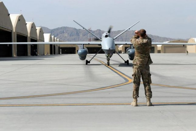 The United States this week conducted airstrikes against Taliban insurgents in Afghanistan, including Kandahar district, near the airfield where an MQ-9 is pictured in 2015. Photo by Sgt. Whitney Amstutz/U.S. Air Force