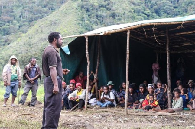 People affected by the earthquake in Papua New Guinea take shelter under a tent. Across the island nation, over 270,000 remain dependent on humanitarian assistance in the aftermath of the disaster and a series of devastating aftershocks. Photo courtesy of the United Nations