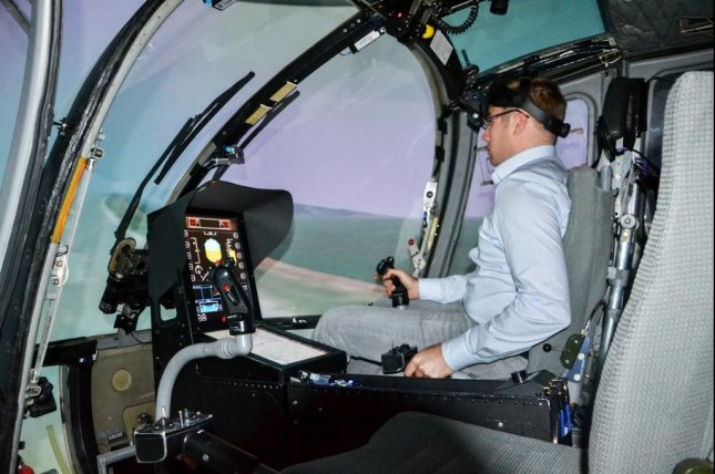 Franz Viertler, an engineer at Technical University of Munich, tries out the new head-mounted augmented reality display in the research simulator. Photo by Technical University of Munich