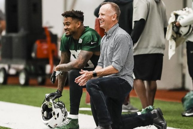 Jets Chairman and CEO Christopher Johnson (R) contributed with a $250,000 pledge to combat social injustice. Photo courtesy of New York Jets/Twitter
