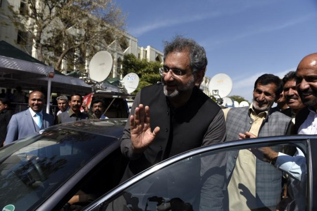 Shahid Khaqan Abbasi, shown here leaving a Pakistani court in March, was arrested on corruption charges Thursday. File Photo by T. Mughal/EPA-EFE
