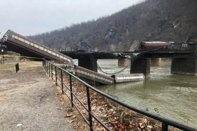 A CSX freight train derailed at the Harpers Ferry crossing in West Virginia early Saturday morning, sending several cars tumbling into the Potomac. Photo courtesy of Washington County Division of Emergency Services