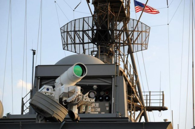An improved version of the HELIOS high energy laser weapon, seen here aboard the USS Ponce, was delivered by Lockheed Martin to the U.S. Navy. Photo courtesy of U.S. Navy